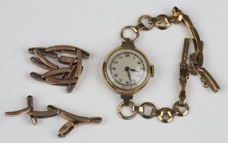 A 9ct gold circular cased lady's wristwatch with unsigned movement, the case back interior