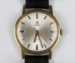 An Omega Genève gilt metal fronted and steel backed gentleman's wristwatch, circa 1970, the signed