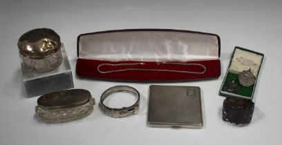 A George V silver engine turned square cigarette case, London 1933 by Thomas William Lack, width 8.