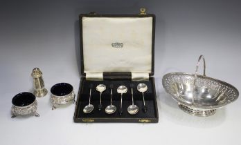 A Victorian silver oval swing handled bonbon basket with pierced and engraved rim and similarly