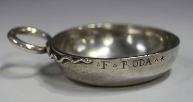 A late 18th century French silver tasse du vin of circular form with entwined snake handle, the side