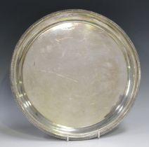 An Elizabeth II silver circular salver with raised reeded rim, Sheffield 1950 by Walker & Hall,