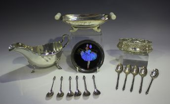 An American sterling sauceboat with scroll handle, on scroll legs terminating in hoof feet, detailed