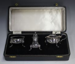 An Elizabeth II silver three-piece condiment set with gadrooned rims, on scroll legs, comprising