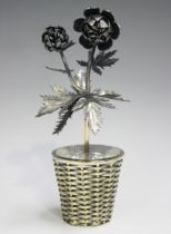 A Tiffany Mexico sterling model of a flower stem in a woven effect basket, designed by Janna Thomas,