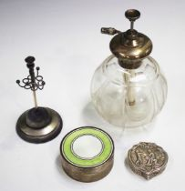 An Edwardian silver and enamelled circular box and cover, the cover enamelled in white and lime