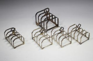 A set of three Elizabeth II silver four-division toast racks, London 1992, length 7.5cm, another