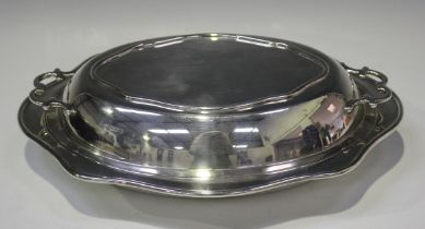 A George V silver oval entrée dish and two-handled cover with wavy rim, Sheffield 1926 by