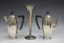 An Edward VIII silver coffee pot and matching hot water pot of elongated ovoid form, on a circular