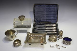 A George V silver shaped rectangular dish with pierced sides and cast scallop shell cornered