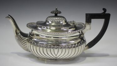 A late Victorian silver teapot of half spiral reeded cushion form, Birmingham 1897 by Thomas
