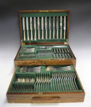 A part canteen of plated Rat Tail pattern cutlery, comprising twelve table knives and forks, four