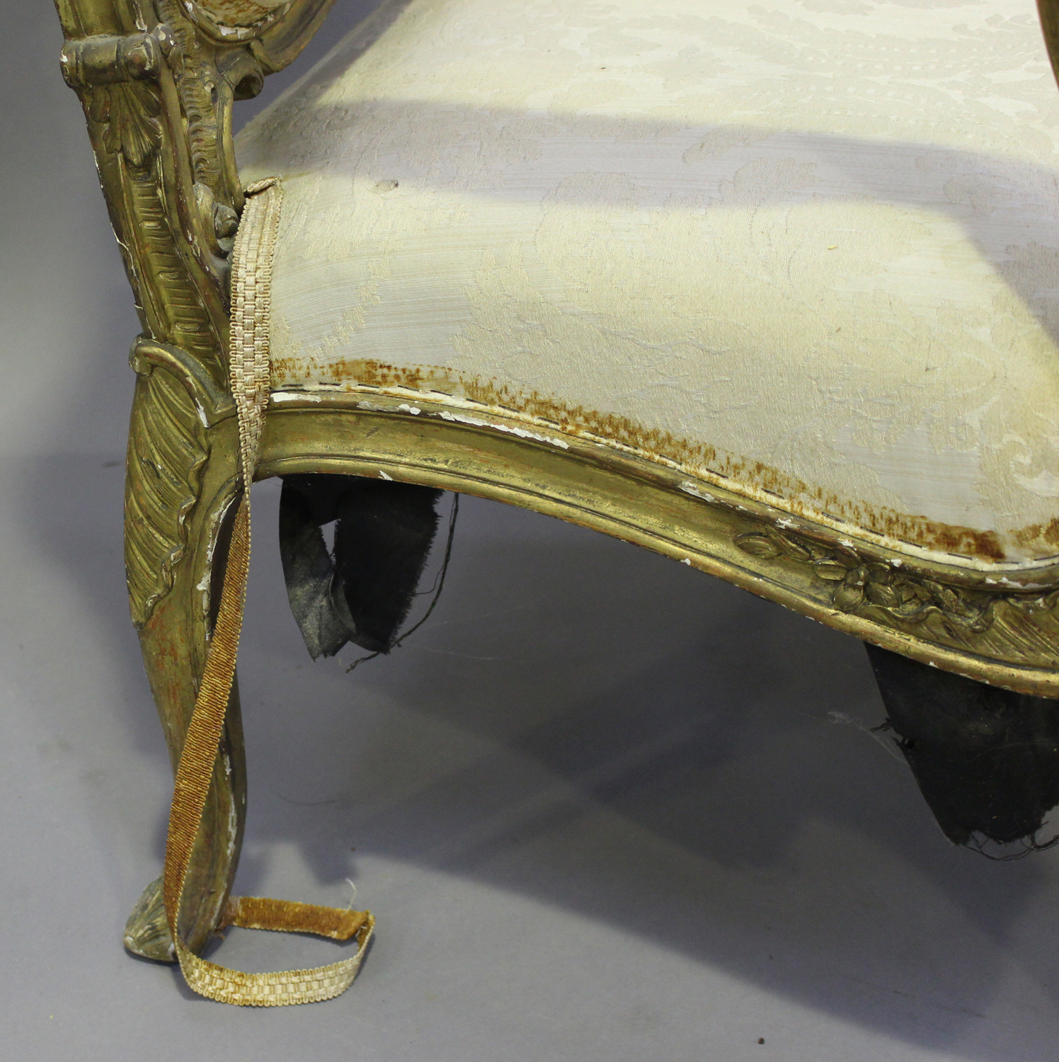 A 19th century French giltwood showframe fauteuil armchair with carved scroll decoration, on - Image 5 of 10