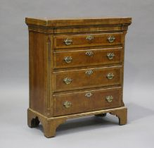 A 20th century George I style walnut bachelor's chest, fitted with a fold-over top and four