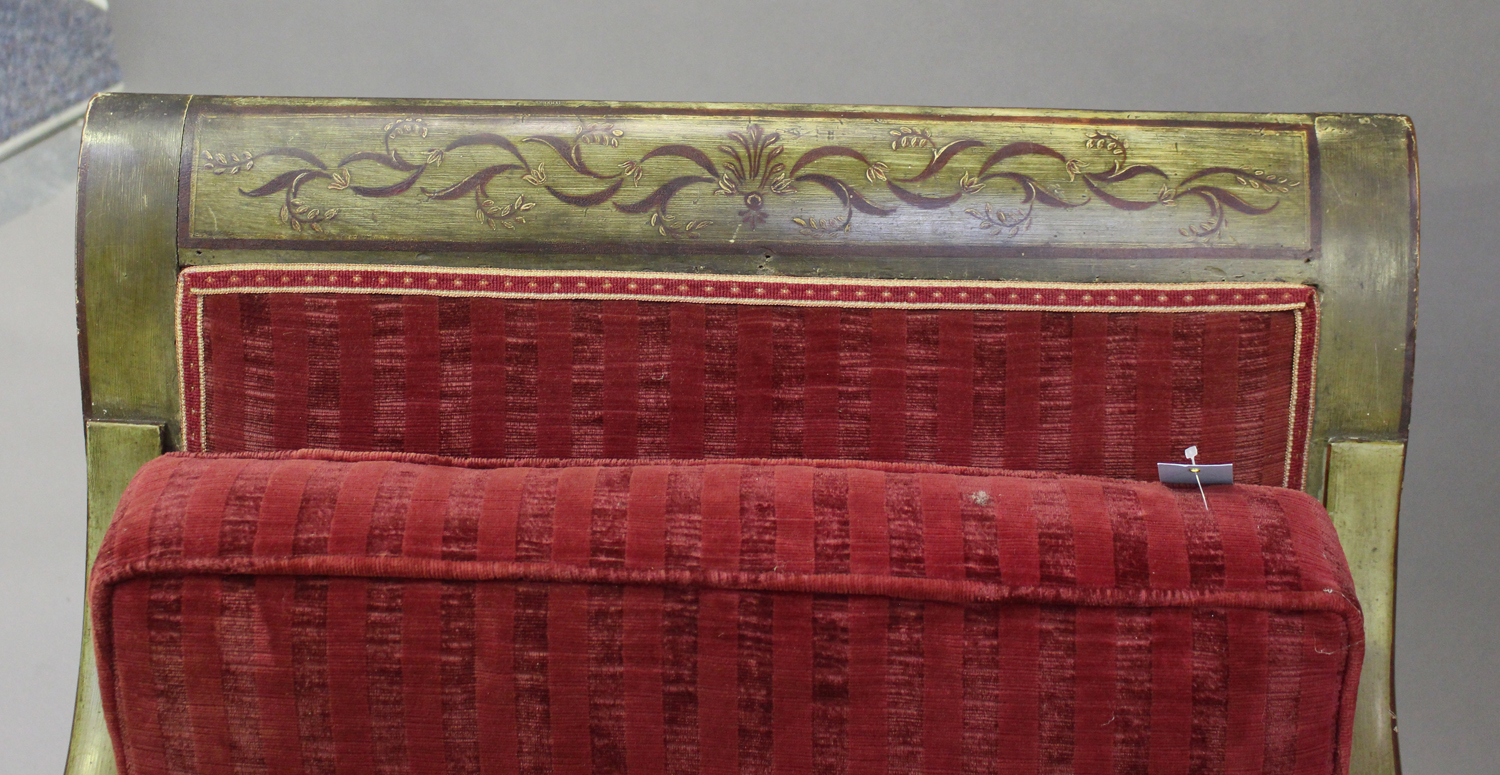 A 19th century Swedish green painted scroll armchair with foliate decoration, upholstered in red - Image 9 of 9