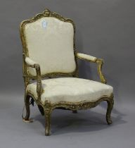 A 19th century French giltwood showframe fauteuil armchair with carved scroll decoration, on