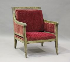 A 19th century Swedish green painted scroll armchair with foliate decoration, upholstered in red