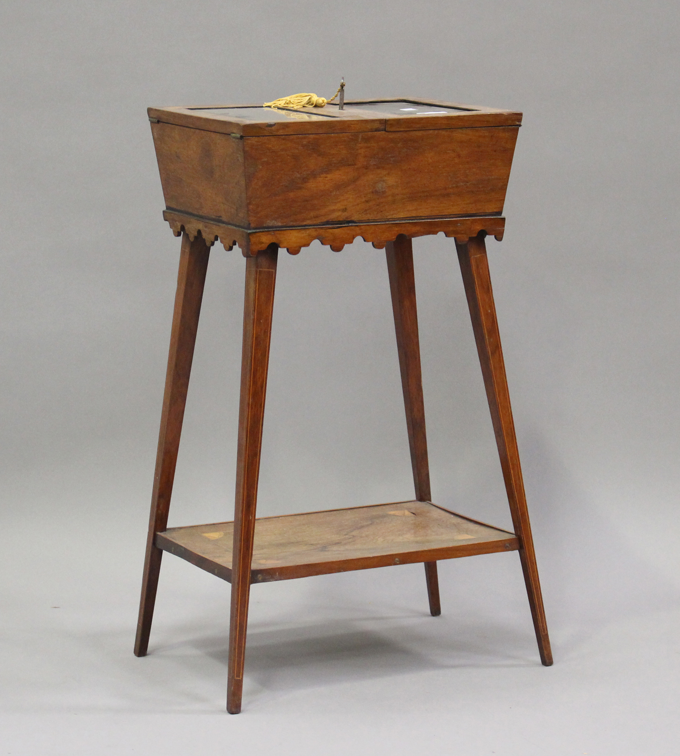 A late Victorian rosewood bijouterie table with inlaid decoration, the double hinged lid raised on