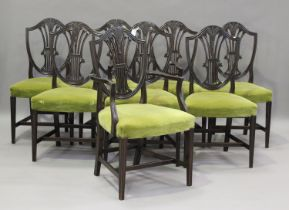 A set of eight early 20th century George III style mahogany dining chairs, comprising two carvers