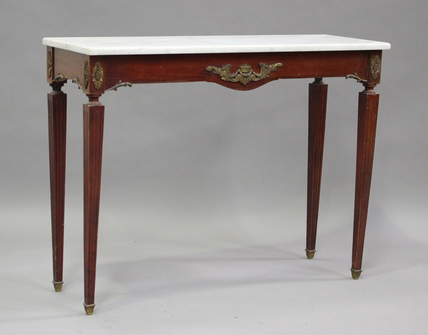 A 20th century Louis XV style mahogany and gilt metal mounted hall table with white marble top, on