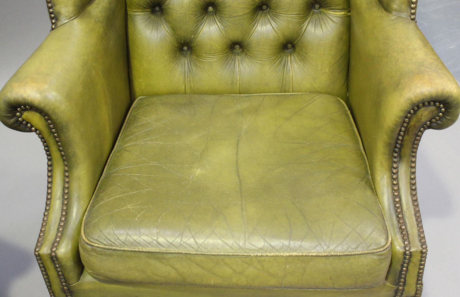 A pair of 20th century George III style wing back armchairs, upholstered in buttoned green - Image 5 of 10