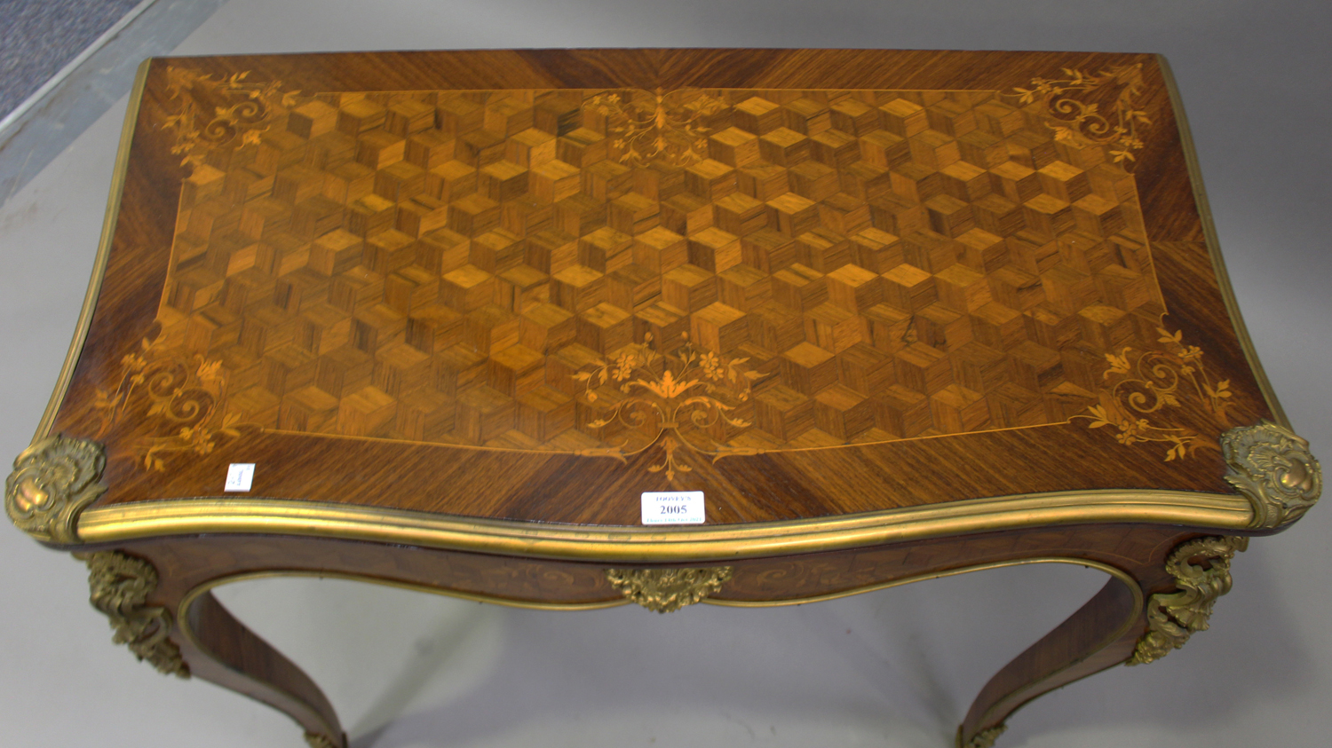 A late 19th century Louis XV style kingwood and parquetry veneered fold-over card table with gilt - Image 7 of 7