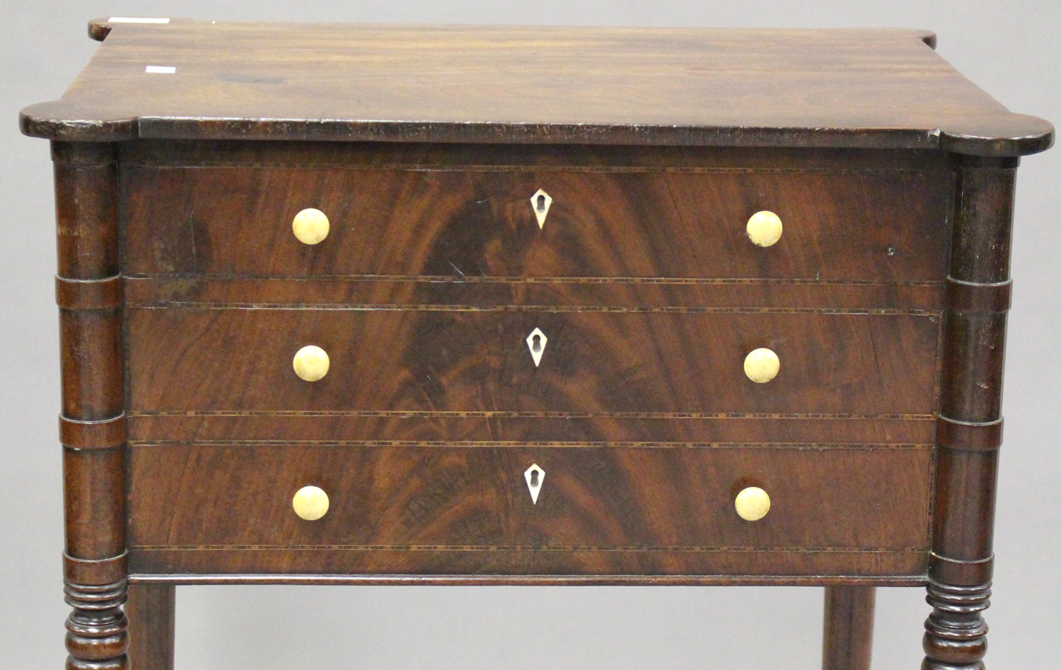 A George IV figured mahogany side table with projecting corners, the two drawers with bone handles - Image 3 of 8