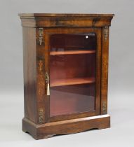 A mid-Victorian walnut and foliate inlaid pier cabinet with gilt metal mounts, fitted with a
