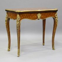 A late 19th century Louis XV style kingwood and parquetry veneered fold-over card table with gilt