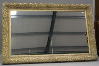 A large, late 19th century giltwood and gesso rectangular wall mirror with leaf scroll decoration,