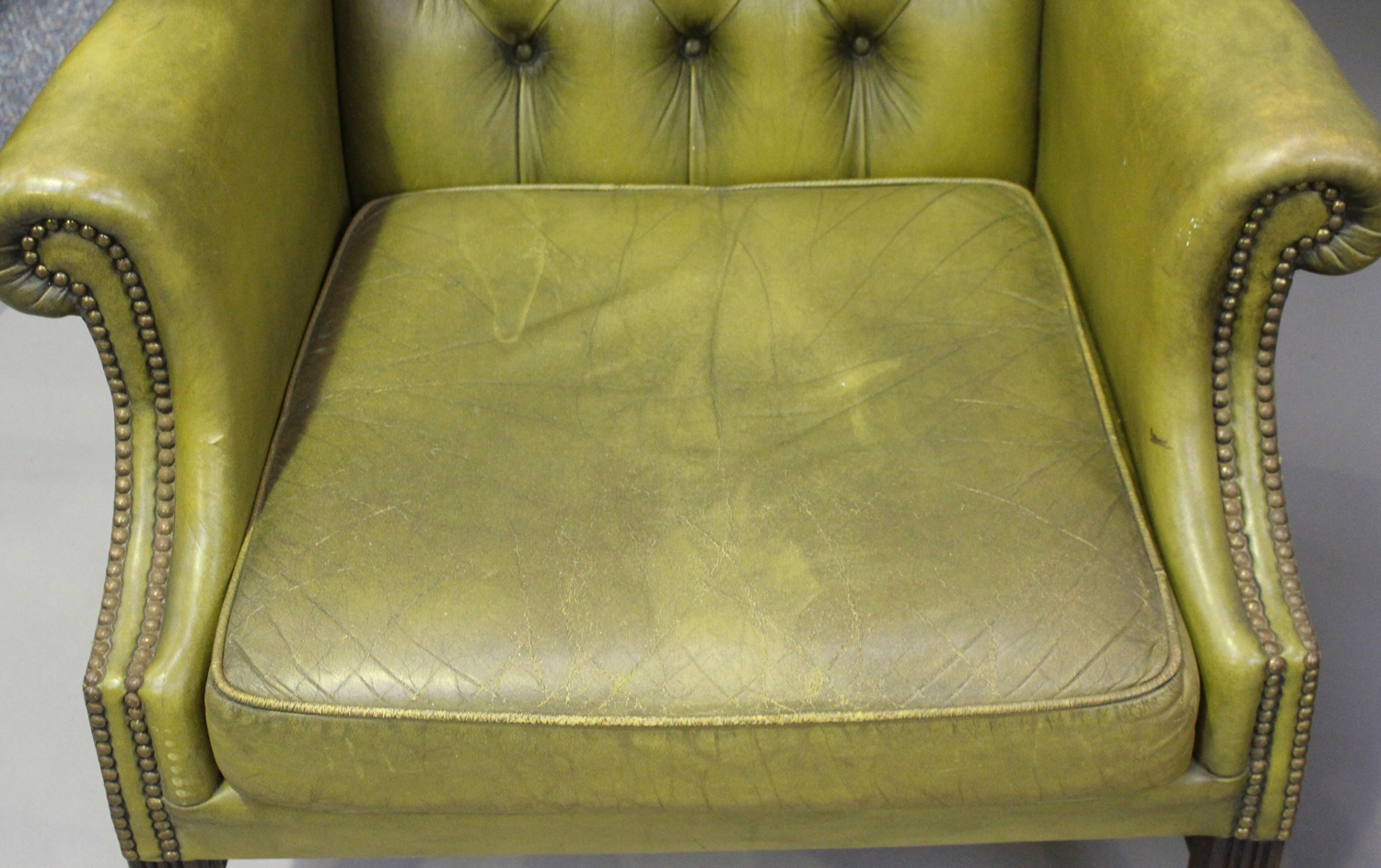 A pair of 20th century George III style wing back armchairs, upholstered in buttoned green - Image 9 of 10