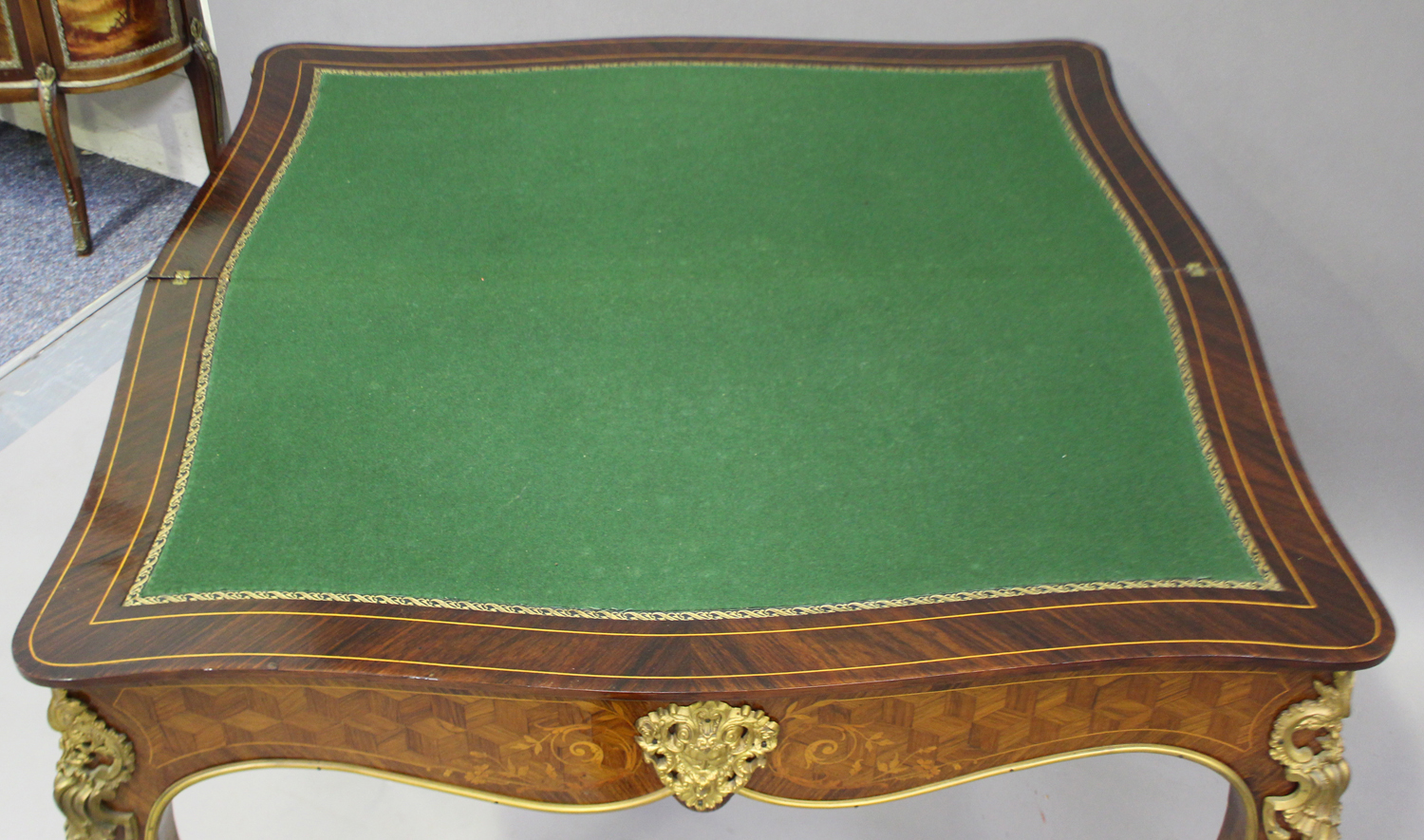 A late 19th century Louis XV style kingwood and parquetry veneered fold-over card table with gilt - Image 2 of 7