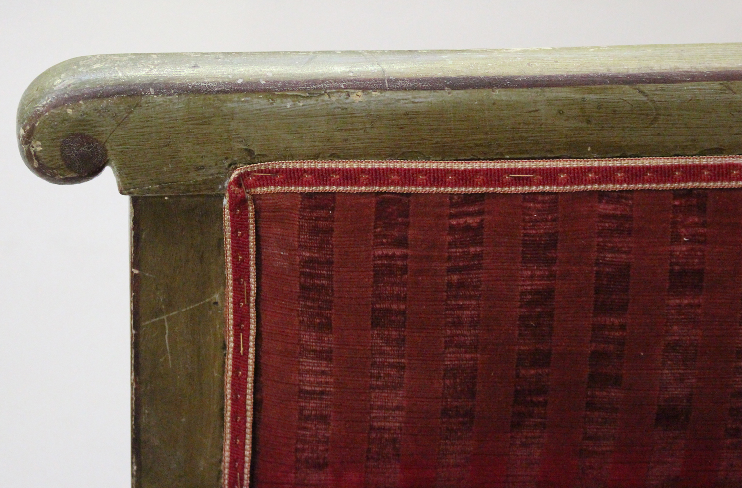 A 19th century Swedish green painted scroll armchair with foliate decoration, upholstered in red - Image 7 of 9