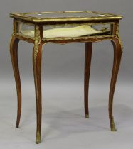 A late 19th/early 20th century French kingwood bijouterie table with gilt metal mounts, the hinged