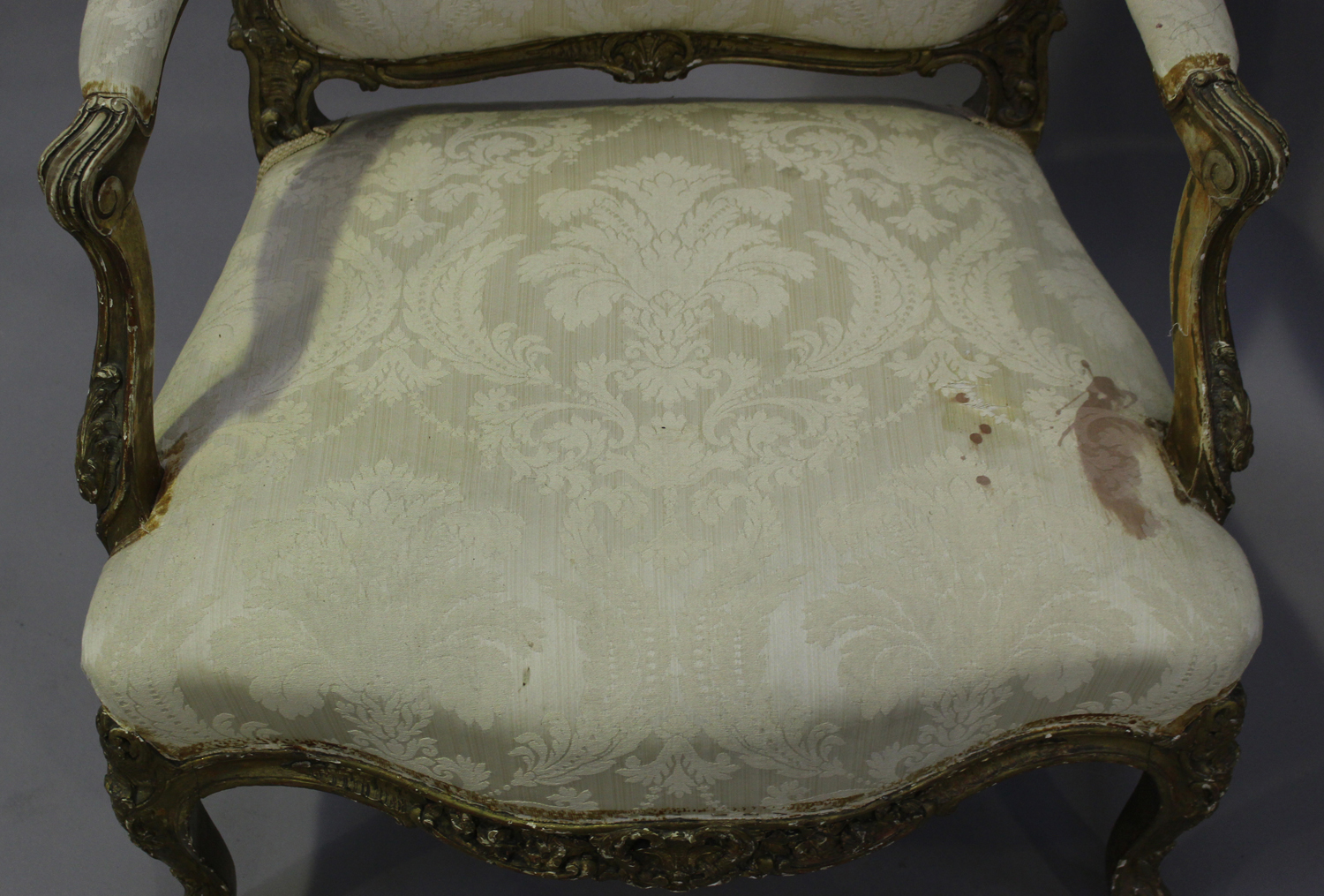 A 19th century French giltwood showframe fauteuil armchair with carved scroll decoration, on - Image 8 of 10