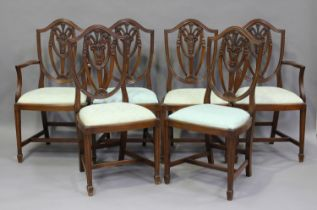 A set of six 20th century reproduction mahogany dining chairs with drop-in seats, comprising two
