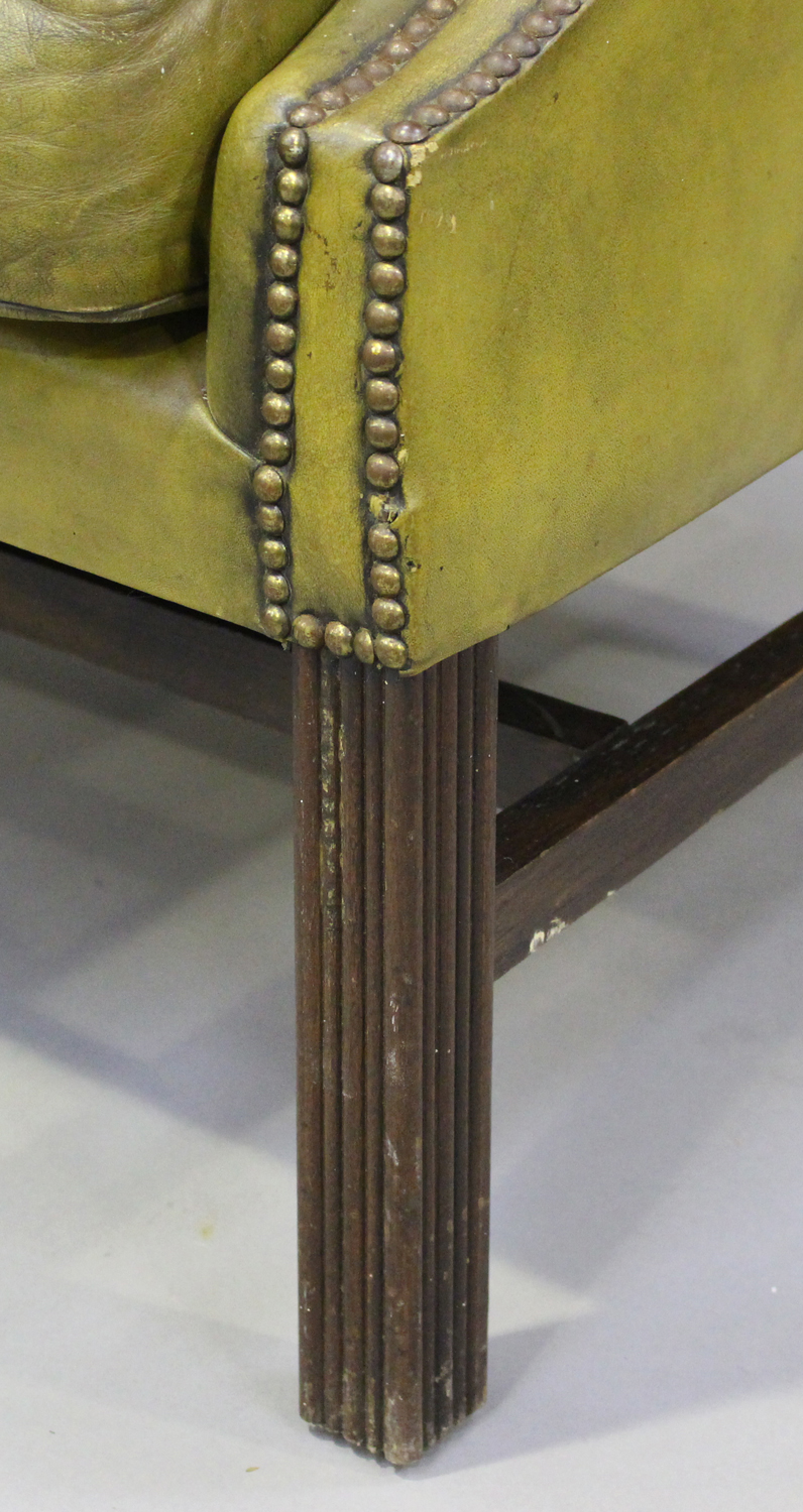 A pair of 20th century George III style wing back armchairs, upholstered in buttoned green - Image 4 of 10