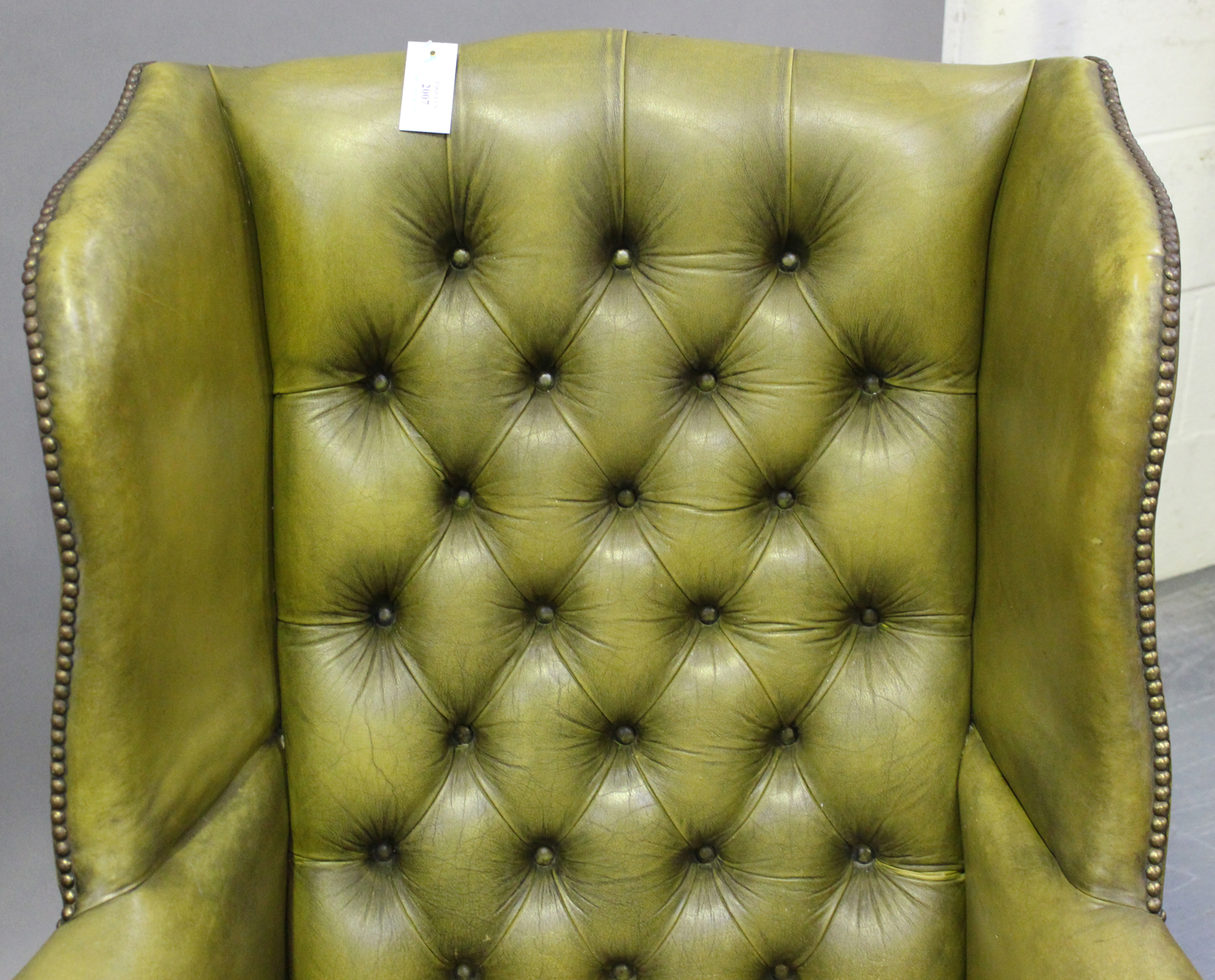 A pair of 20th century George III style wing back armchairs, upholstered in buttoned green - Image 6 of 10