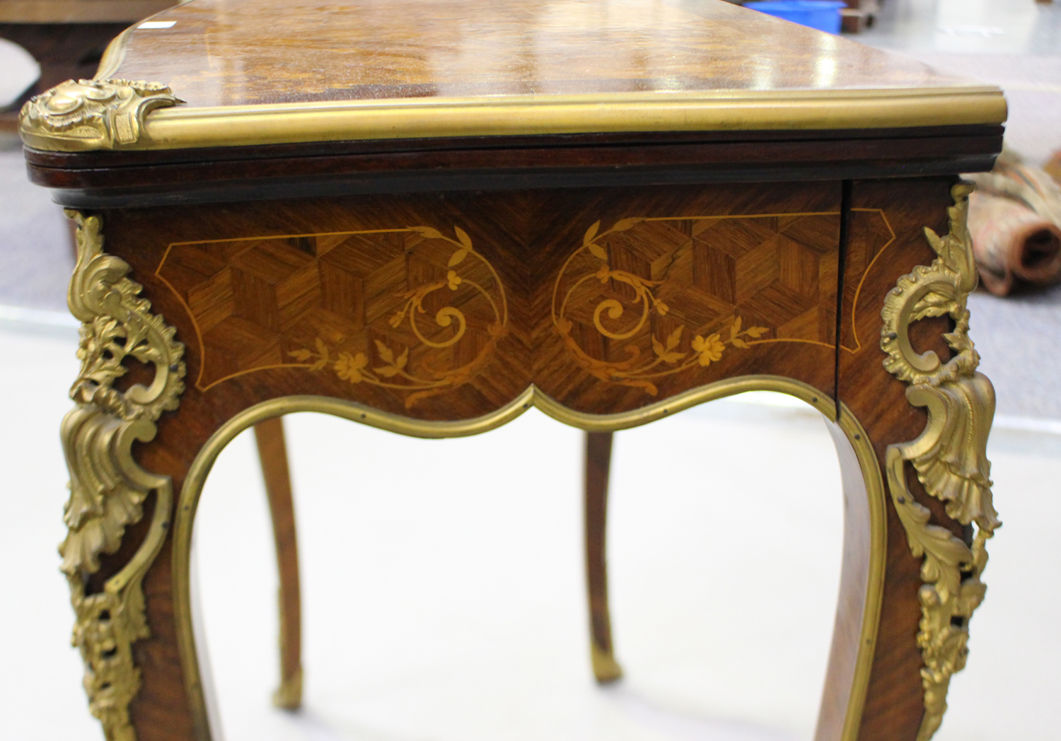 A late 19th century Louis XV style kingwood and parquetry veneered fold-over card table with gilt - Image 4 of 7