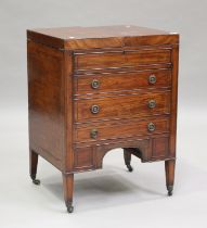 A George III mahogany dressing table, the double hinged top revealing a compartmentalized interior