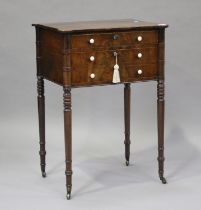 A George IV figured mahogany side table with projecting corners, the two drawers with bone handles