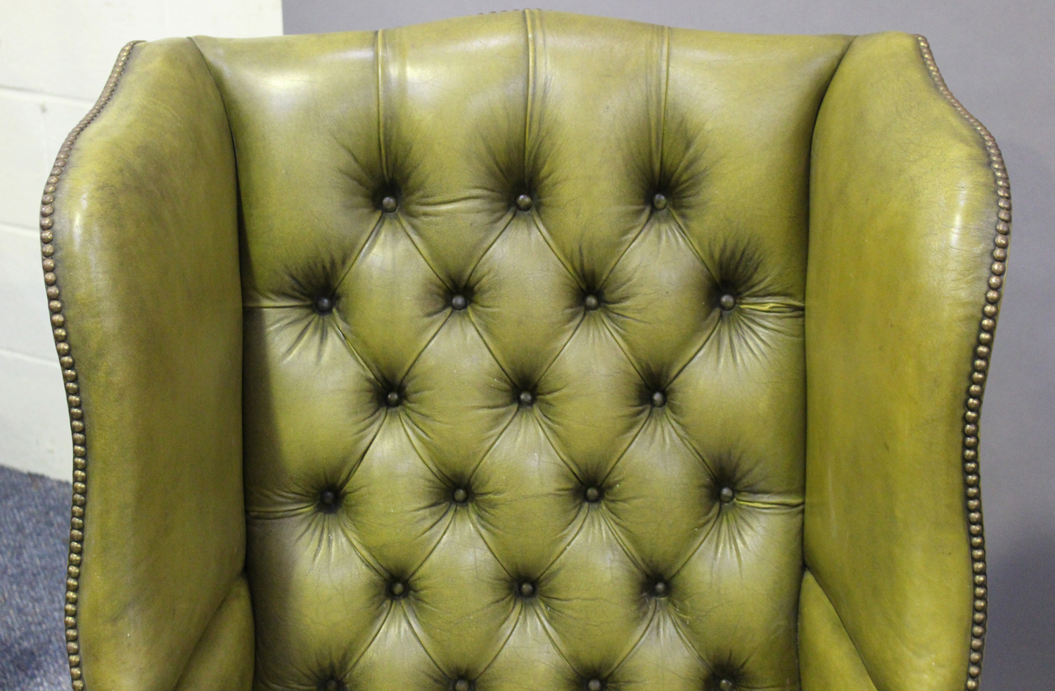 A pair of 20th century George III style wing back armchairs, upholstered in buttoned green - Image 10 of 10