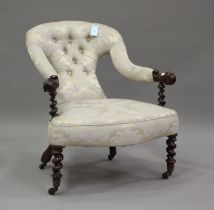 A 19th century mahogany framed scroll armchair, upholstered in blue damask, on barley twist legs,