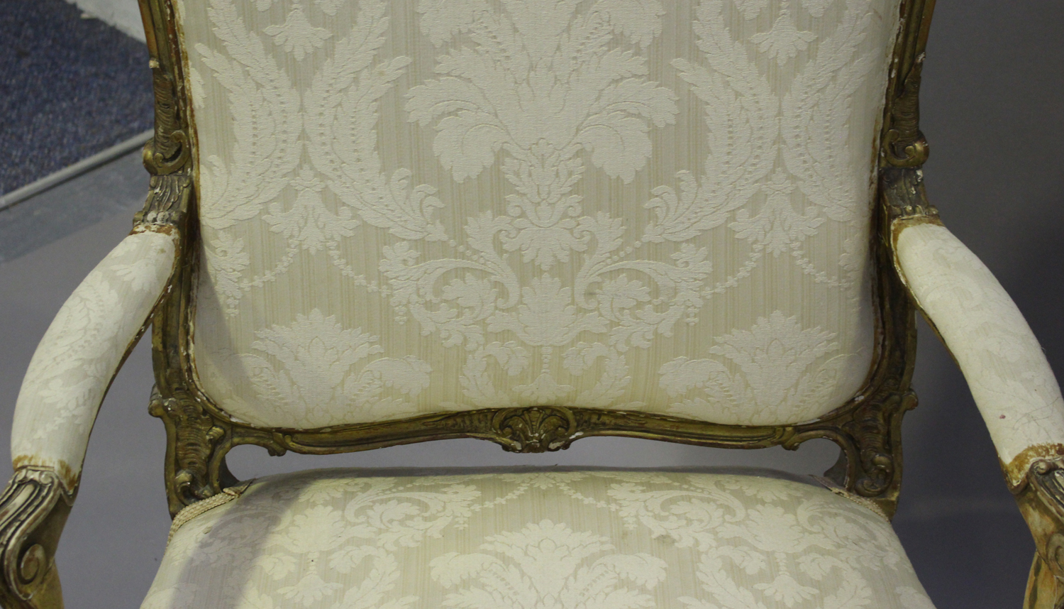 A 19th century French giltwood showframe fauteuil armchair with carved scroll decoration, on - Image 9 of 10