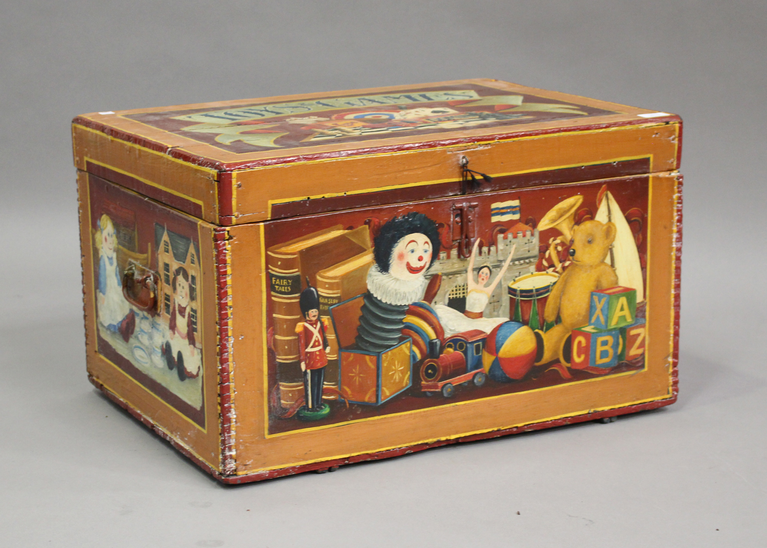 A late Victorian toy box, later polychrome painted throughout with toys and dolls, with applied