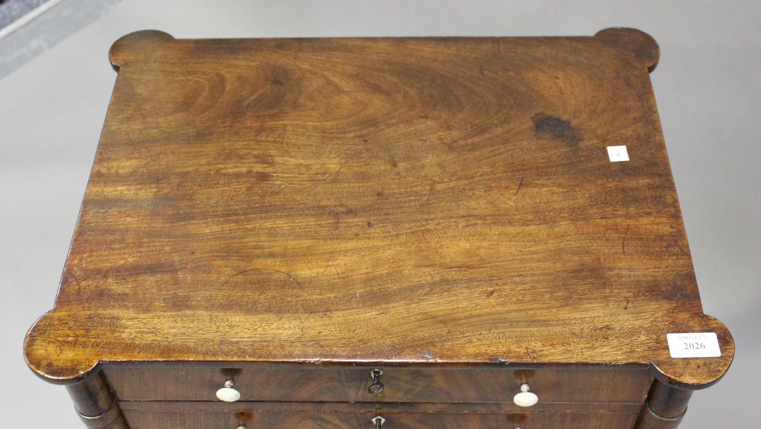 A George IV figured mahogany side table with projecting corners, the two drawers with bone handles - Image 8 of 8