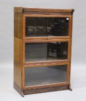 An early 20th century Globe Wernicke style oak three-section bookcase, height 136cm, width 88cm,