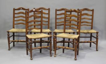 A set of six early 19th century provincial fruitwood ladder back kitchen chairs, height 95cm,