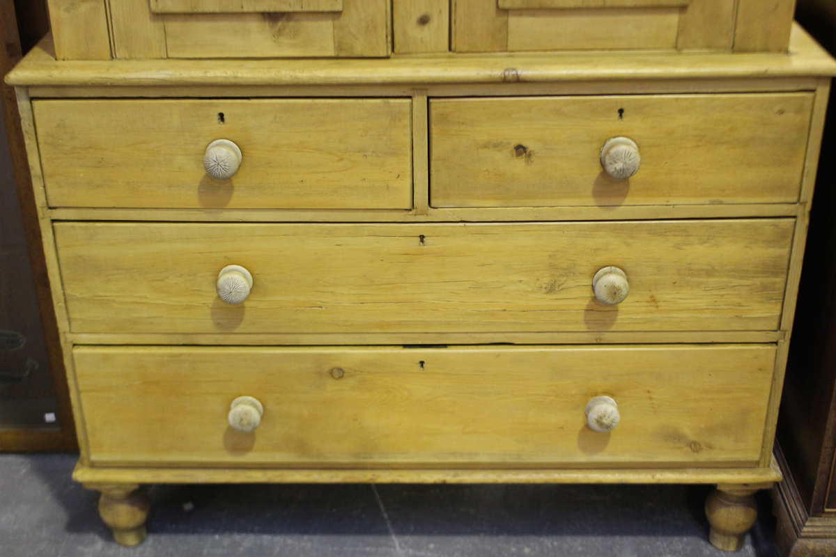 A late Victorian pine linen press, fitted with a pair of panel doors above two short and two long - Image 2 of 5