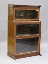 An early 20th century Globe Wernicke style oak three-section bookcase, height 147cm, width 87cm,